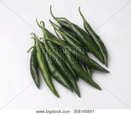 Bunch Of Green Chili Peppers Isolated On White Background