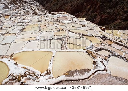 Salt Evaporation Ponds In The Town Of Maras In The Sacred Valley Near Cusco, Peru