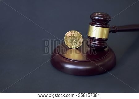Crypto Currency Law Theme, Gavel And Bitcoin Symbol On Brown Table With Copyspace.