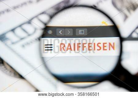 Russia, St.petersburg - August 12, 2020: Logo Raiffeisen Schweiz On The Website Screen Through A Mag
