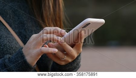 Woman touch on cellphone at outdoor