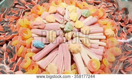 Many Colorful Abstract Marshmallows And Marmalade On Market. Pattern Of Jelly Sweet Candies. Food Te