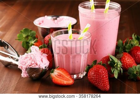 Glass Of Fresh Strawberry Shake, Smoothie Or Milkshake And Fresh Strawberries On Table. Healthy Food