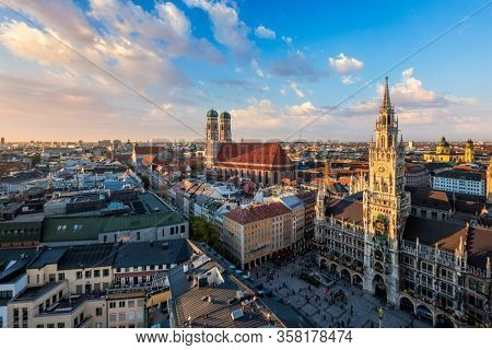 Aerial view of Munich - Marienplatz, Neues Rathaus and Frauenkirche from St. Peter's church on sunset. Munich, Germany