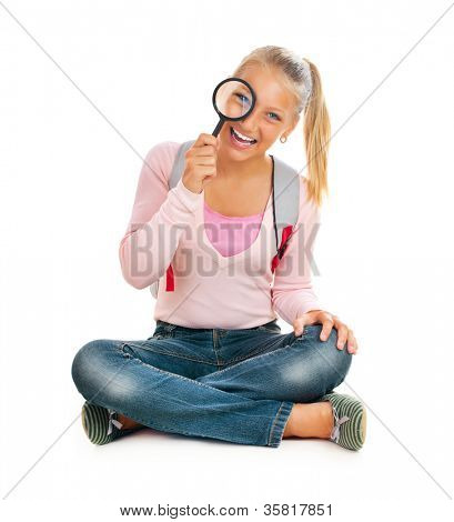 Schoolgirl or Student with Magnifying Glass.Back To School Concept.Isolated On A White Background
