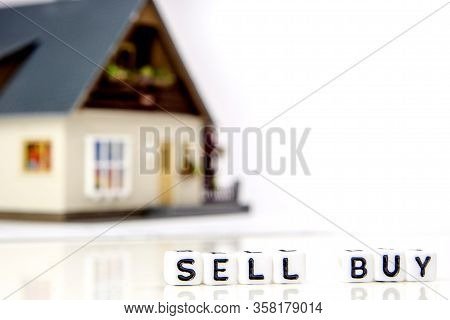 The Decision About Sell Or Buy A New Residence As An Investment Oportunity, A Team Of Miniature Figu
