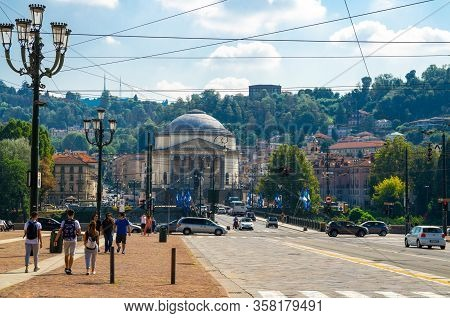 Turin, Italy, September 10, 2018: People Are Walking Down Piazza Vittorio Veneto Square, View Of Cat
