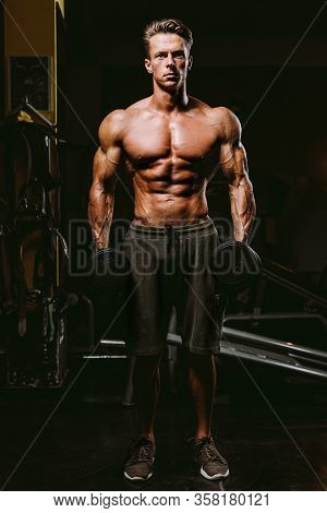 Handsome Fit Man Tightening His Muscles