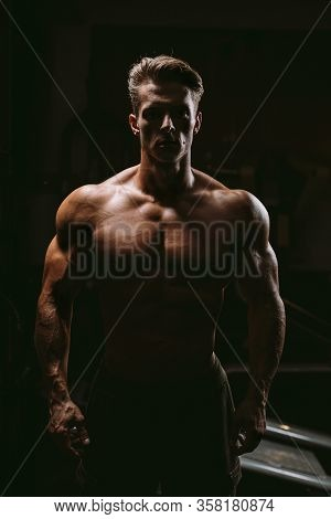Silhouette Of Muscular Man In Gym