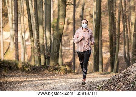 Corona Virus, Or Covid-19, Is Spreading All Over The World. Portrait Of Caucasian Sporty Woman Weari