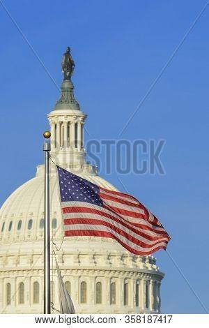United States Capitol Building and US National flag - Washington DC, United States of America