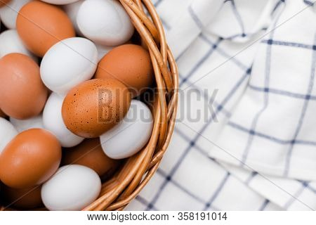 Chicken Eggs On A Checked Kitchen Towel On A Light Table. Concept Of Farm Products And Natural Food.