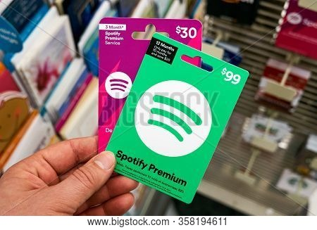 Montreal, Canada - March 24, 2020: Spotify Green Gift Card In A Hand At Store Over Gift Cards. Spoti