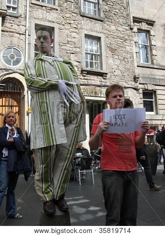 EDINBURGH- AUGUST 11: Members of Fat Git Theatre publicize their show Uninvited during Edinburgh Fringe Festival on August 11, 2012 in Edinburgh