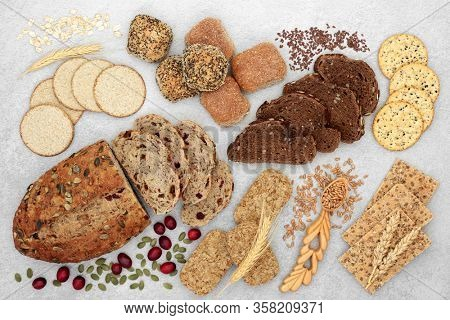 High fibre food for good health concept with bread, crackers, seeds & grain. High in antioxidants, omega 3, vitamins & protein with low GI levels for diabetics. Lowers blood pressure & cholesterol.