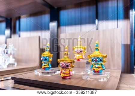 Tiny Tos-sa-kan, The Giant Toy In Ramayana Dramatic Serie From South East Asia In The Wood Shelf.