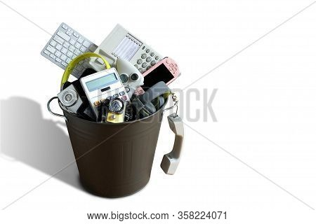 Electronic Waste Broken Or Damage In Dustbin Isolated On White Background And Leave Blank Space Abov