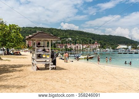 Ocho Rios, Jamaica - April 22, 2019: Ocho Rios Bay Beach With Lifeguard Tower And People Relaxing On