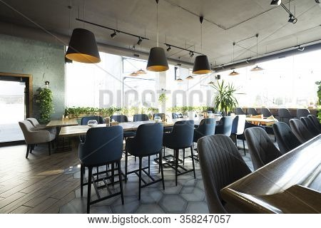 Cozy Cafe Interior With Empty Places For Eating And Resting, Big Panoramic Windows, Copy Space