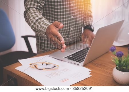 Businessman Holding Handshake, Concept Of Business Communication.