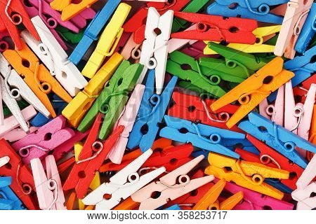 Multi-colored Wooden Clothespins As A Full-screen Texture And Background. Decorative Clothespins For