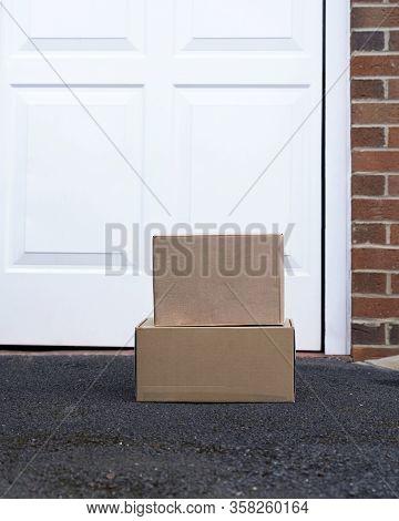 Parcel Cardboard Box In Front Door.door To Door Delivery Of Good Merchandises While The Quarantine,d