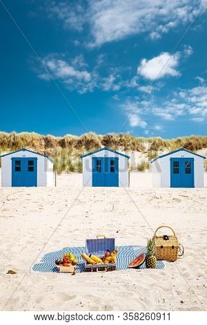 Picnic On The Beach Texel Netherlands, Couple Having Picnic On The Beach Of Texel With White Sand An