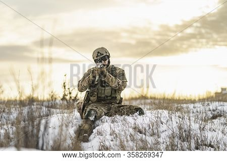 Modern War Soldier Army Man In The Winter Multicam Camouflage Is Patrolling Or Patrol Field Territor