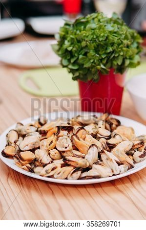 Peeled Mussels On A White Plate At A Cooking Class. Master Class On Seafood. Cooking Mussels.