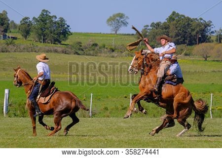 Caminos, Canelones, Uruguay, Oct 7, 2018: Gaucho Riding On A Wild Untamed Horse At A Criolla Festiva