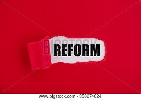 Text, Word Reform On A Red Background.