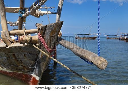 Prow Of The Ancient Wooden African Boat In Detail , Fastening Elements. Boats On The Ocean Surface,