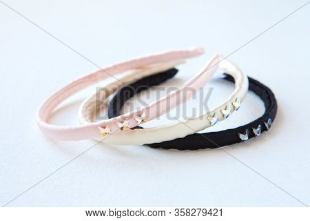 Black, Yellow And Pink Silk Hair Hoops Isolated On White. Flat Lay Hairdressing Tools And Accessorie