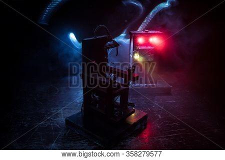 Death Penalty Electric Chair Miniature On Dark. Creative Artwork Decoration.
