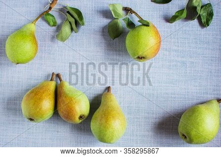 Pears In A Plate And Slices Of Pears Top View. Wooden Background With Pears