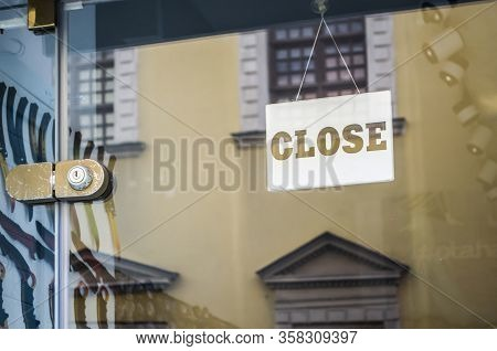 The Sign Close On The Window Of The City Store. Quarantine Closure Of Small Business, Concept Photo.