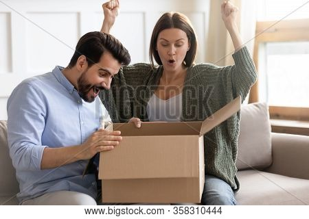 Overjoyed Married Couple Excited By Received Present From International Store.