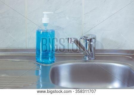 Liquid Hygienic Soap Of Blue Color. Coronavirus Prophylaxis, Hand Sanitizer. Hygiene Concept.
