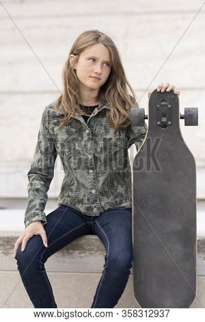 Portrait Of Young Girl With Skateboard, France