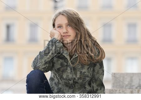 Horizontal Portrait Of Young Girl Outdoor, France
