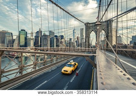 Taxi On The Brooklyn Bridge, New York, Usa