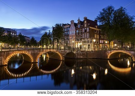 Famous Bridge In Amsterdam By Night, Holland