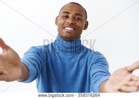 Close-up Portrait Of Handsome, Lovely, Friendly-looking African American Man Reaching Hands Forward