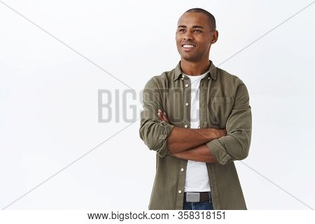 Portrait Of Pleased And Proud Handsome African-american Man, Cross Arms On Chest Confident, Contempl