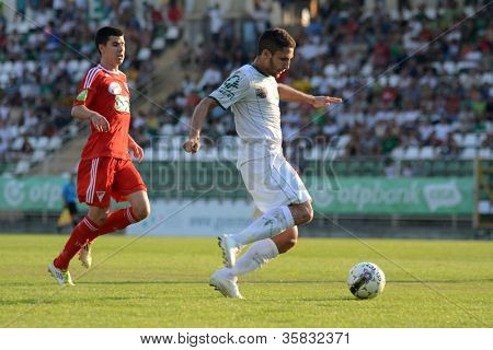 KAPOSVAR, HUNGARY - AUGUST 4: Drazen Okuka (in white) in action at a Hungarian National Championship soccer game Kaposvar (white) vs Debrecen (red) August 4, 2012 in Kaposvar, Hungary.