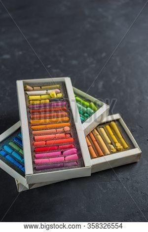 Set Of Pastels Of Different Colors On A Dark Background.the Gradient Transition Of Color Tones.