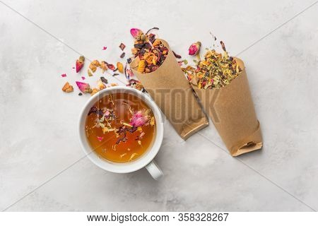 Fresh Tea From Medicinal Herbs, Dry Fruits With Rose Petals In A White Cup. Summer Refreshing Drink.
