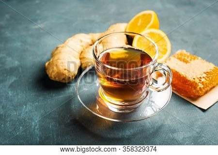 Tea With Ginger, Lemon And Honey. Transparent Cup With Black Tea On Concrete Background.