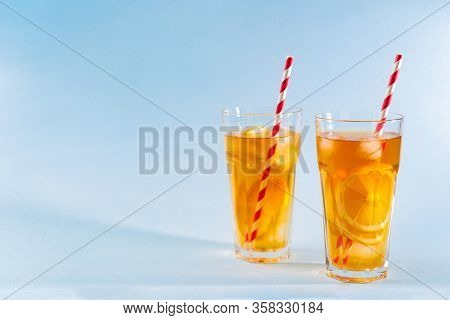 Iced Tea With Lemon In Clear Glasses On Blue Background