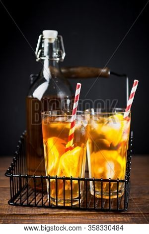 Cold Iced Tea With Lemon In A Transparent Glass On Wooden Background